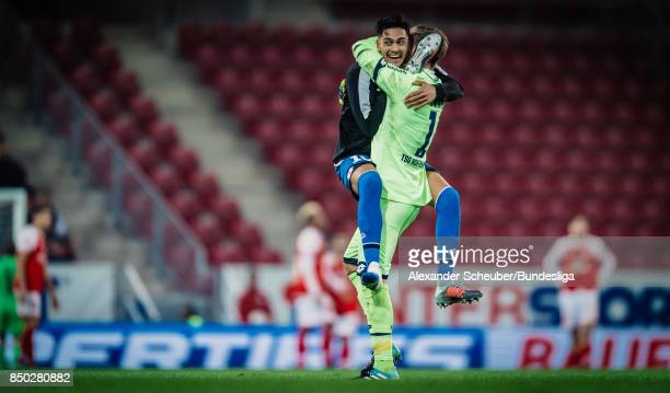 Nadiem Amiri of Hoffenheim celebrates the victory with Oliver Baumann of Hoffenheim during to the Bundesliga match between 1 FSV Mainz 05 and TSG...