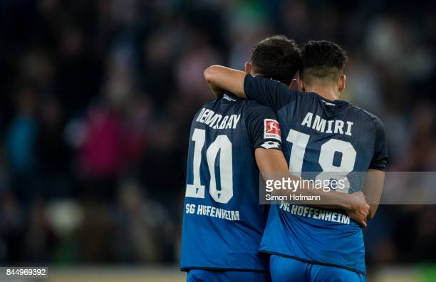 Nadiem Amiri of Hoffenheim celebrates winning with Kerem Demirbay during the Bundesliga match between TSG 1899 Hoffenheim and FC Bayern Muenchen at...