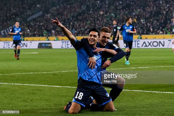 Nadiem Amiri of Hoffenheim celebrates with Pavel Kaderabek after scoring a goal to make it 11 during the Bundesliga match between Borussia...