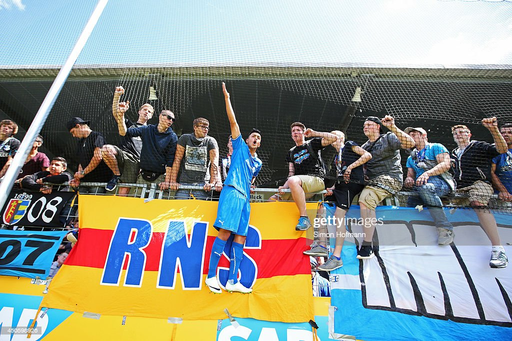 Nadiem Amiri of Hoffenheim celebrates with supporters after the A Juniors Bundesliga Semi Final between 1899 Hoffenheim and FC Schalke 04 at Dietmar Hopp-Stadium on June 14, 2014 in Hoffenheim, Germany.