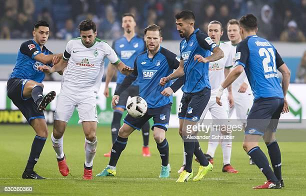 Nadiem Amiri of Hoffenheim challenges Claudio Pizzaro of Bremen during the Bundesliga match between TSG 1899 Hoffenheim and Werder Bremen at Wirsol...