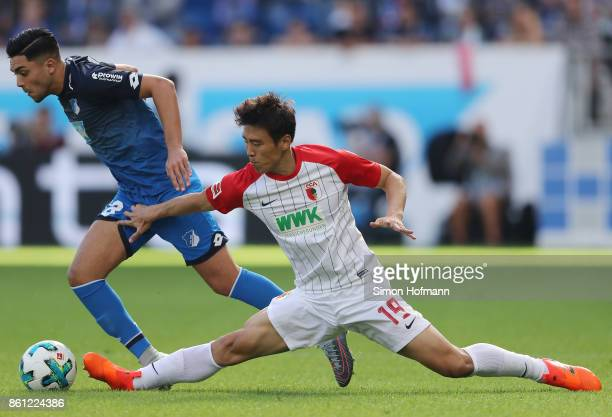 Nadiem Amiri of Hoffenheim fights for the ball with Koo Jacheol of Augsburg during the Bundesliga match between TSG 1899 Hoffenheim and FC Augsburg...