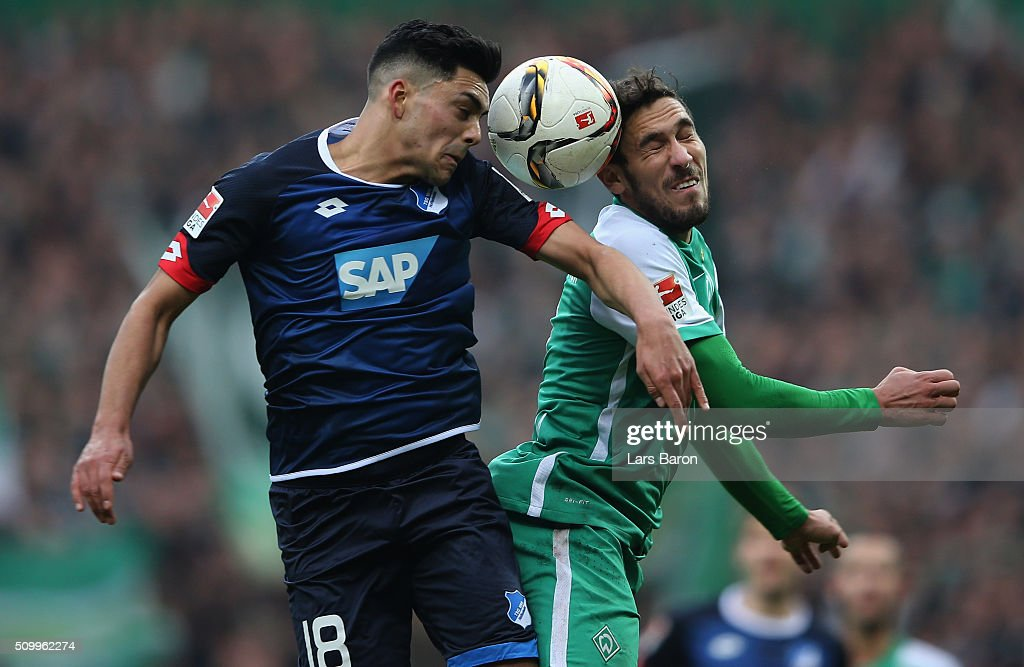 Nadiem Amiri of Hoffenheim goes up for a header with Santiago Garcia of Bremen during the Bundesliga match between Werder Bremen and 1899 Hoffenheim at Weserstadion on February 13, 2016 in Bremen, Germany.