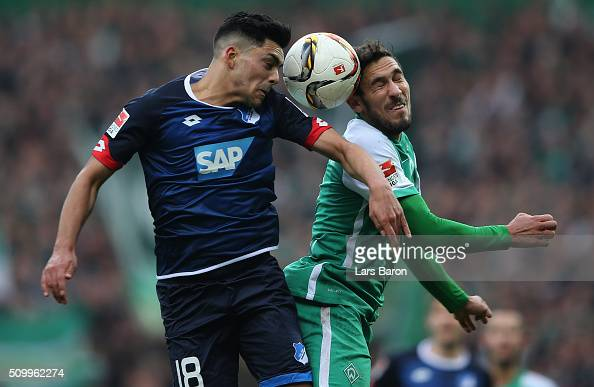 Nadiem Amiri of Hoffenheim goes up for a header with Santiago Garcia of Bremen during the Bundesliga match between Werder Bremen and 1899 Hoffenheim...