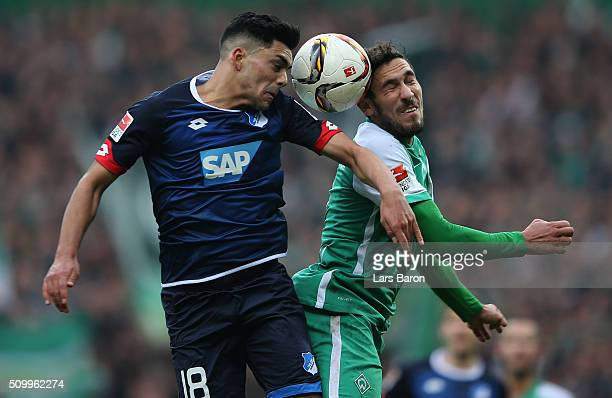 Nadiem Amiri of Hoffenheim goes up for a header with Santiago Garcia of Bremen during the Bundesliga match between Werder Bremen and 1899 Hoffenheim...