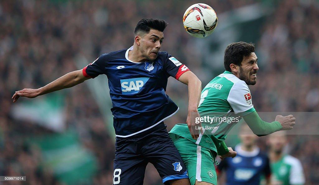 Nadiem Amiri of Hoffenheim goes up for a header with Santiago Garcia of Bremen during the Bundesliga match between Werder Bremen and 1899 Hoffenheim at Weserstadion on February 13, 2016 in Bremen, Germany.
