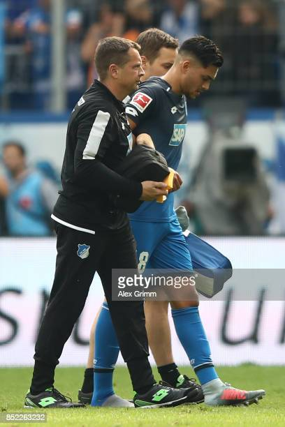 Nadiem Amiri of Hoffenheim has to leave the match injured during the Bundesliga match between TSG 1899 Hoffenheim and FC Schalke 04 at Wirsol...