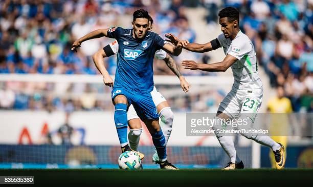 Nadiem Amiri of Hoffenheim in action against Gebre Selassie of Bremen during the Bundesliga match between TSG 1899 Hoffenheim and SV Werder Bremen at...