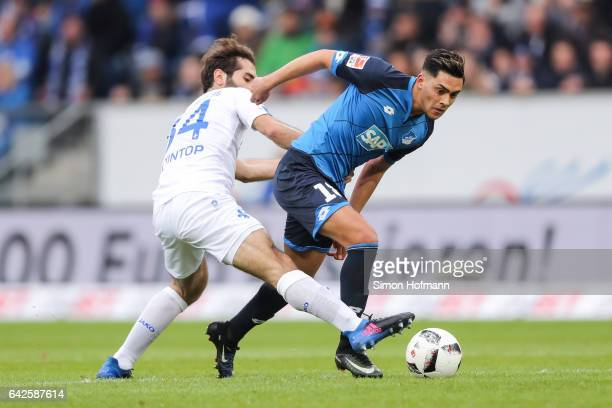Nadiem Amiri of Hoffenheim is challenged by Hamit Altintop of Darmstadt during the Bundesliga match between TSG 1899 Hoffenheim and SV Darmstadt 98...