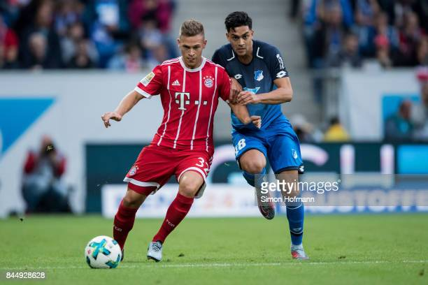 Nadiem Amiri of Hoffenheim is challenged by Joshua Kimmich of Muenchen during the Bundesliga match between TSG 1899 Hoffenheim and FC Bayern Muenchen...
