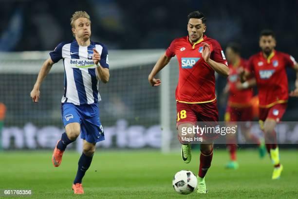 Nadiem Amiri of Hoffenheim is challenged by Per Skjelbred of Berlin during the Bundesliga match between Hertha BSC and TSG 1899 Hoffenheim at...