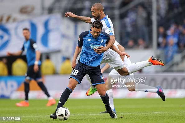 Nadiem Amiri of Hoffenheim is challenged by Terrence Boyd of Darmstadt during the Bundesliga match between TSG 1899 Hoffenheim and SV Darmstadt 98 at...