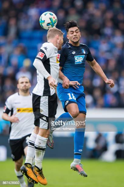 Nadiem Amiri of Hoffenheim jumps for a header with Nico Elvedi of Moenchengladbach during the Bundesliga match between TSG 1899 Hoffenheim and...