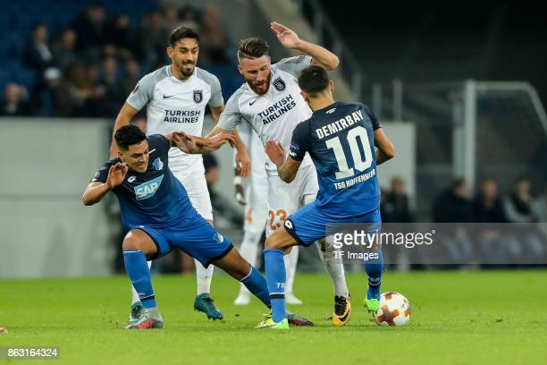Nadiem Amiri of Hoffenheim Kerem Demirbay of Hoffenheim and Tunay Torun of Istanbul Basaksehir battle for the ball during the UEFA Europa League...