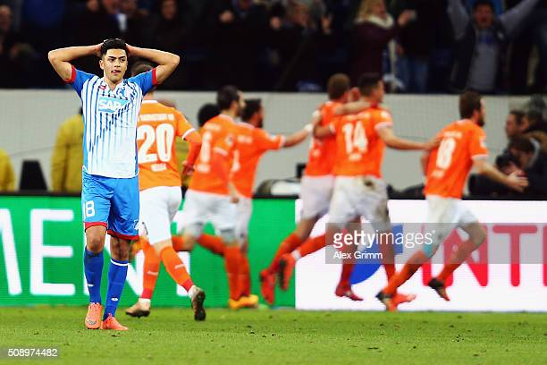 Nadiem Amiri of Hoffenheim reacts as Slobodan Rajkovic of Darmstadt celebrates his team's second goal with team mates during the Bundesliga match...