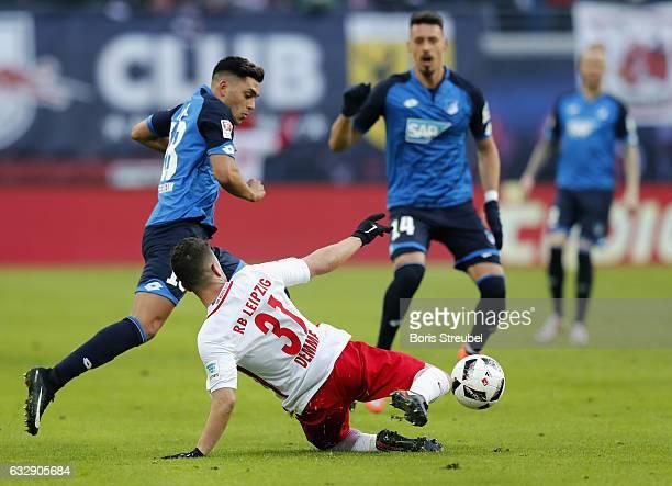 Nadiem Amiri of TSG Hoffenheim is challenged by Diego Demme of RB Leipzig during the Bundesliga match between RB Leipzig and TSG 1899 Hoffenheim at...