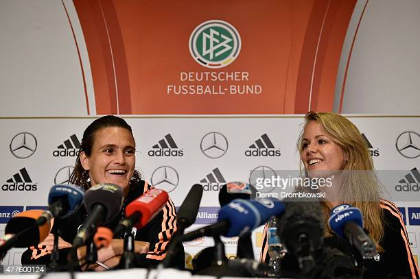 Nadine Angerer and Lena Petermann of Germany face the media during a press conference at The Westin Hotel on June 18 2015 in Ottawa Canada