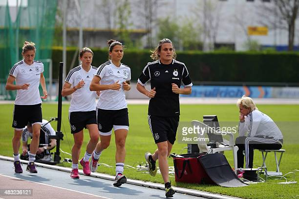 Nadine Angerer Dzsenifer Marozsan Annike Krahn and Bianca Schmidt run during a Germany women's national team performance test on April 7 2014 in...