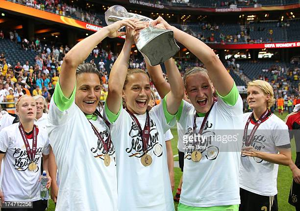 Nadine Angerer goalkeeper and captain of Germany and the goalkeepers' substitutes Laura Benkarth and Almuth Schult celebrate Germany's victory after...