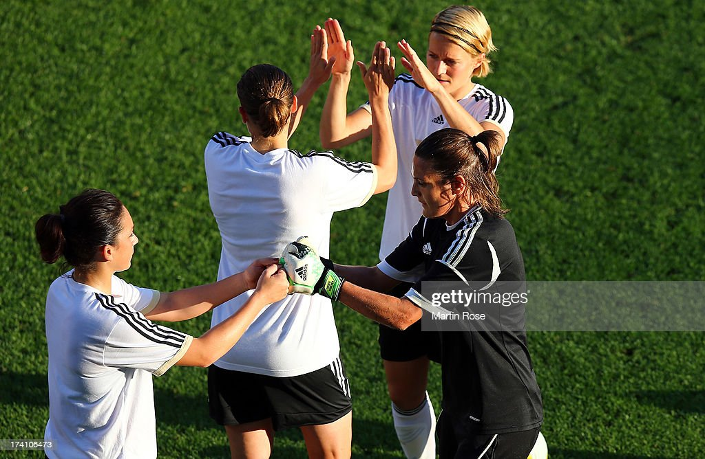 <a gi-track='captionPersonalityLinkClicked' href=/galleries/search?phrase=Nadine+Angerer&family=editorial&specificpeople=2149437 ng-click='$event.stopPropagation()'>Nadine Angerer</a> (R), goalkeeper of Germany celebrate with team mate <a gi-track='captionPersonalityLinkClicked' href=/galleries/search?phrase=Nadine+Kessler&family=editorial&specificpeople=683339 ng-click='$event.stopPropagation()'>Nadine Kessler</a> (L) during the training session of Germany at Vaxjo Arena on July 20, 2013 in Vaxjo, Sweden.