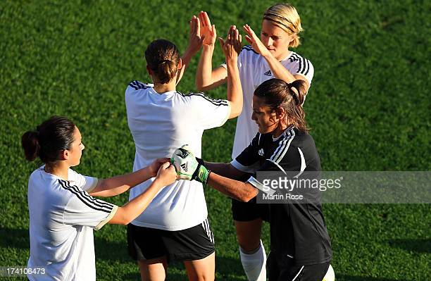 Nadine Angerer goalkeeper of Germany celebrate with team mate Nadine Kessler during the training session of Germany at Vaxjo Arena on July 20 2013 in...