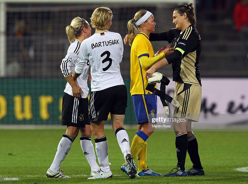 Nadine Angerer (R), goalkeeper of Germany comforts Sara Thunebro (C) of Sweden after the Women's International friendly match between Germany and Sweden on October 26, 2011 in Hamburg, Germany.