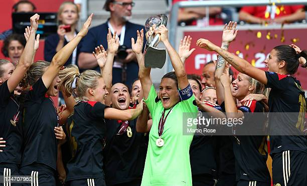 Nadine Angerer goalkeeper of Germany lifts the trophy after the UEFA Women's EURO 2013 final match between Germany and Norway at Friends Arena on...