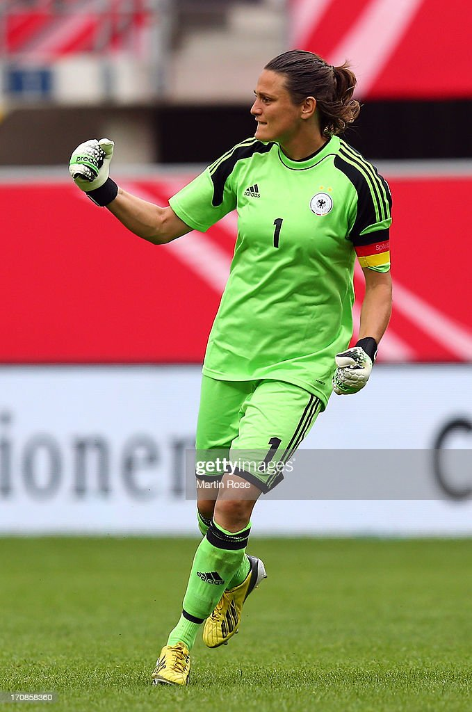 Nadine Angerer, goaltkeeper of Germany celebrates her team's opening goal during the Women's International Friendly match between Germany and Canada at Benteler Arena on June 19, 2013 in Paderborn, Germany.