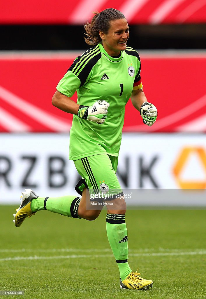 <a gi-track='captionPersonalityLinkClicked' href=/galleries/search?phrase=Nadine+Angerer&family=editorial&specificpeople=2149437 ng-click='$event.stopPropagation()'>Nadine Angerer</a>, goaltkeeper of Germany celebrates her team's opening goal during the Women's International Friendly match between Germany and Canada at Benteler Arena on June 19, 2013 in Paderborn, Germany.