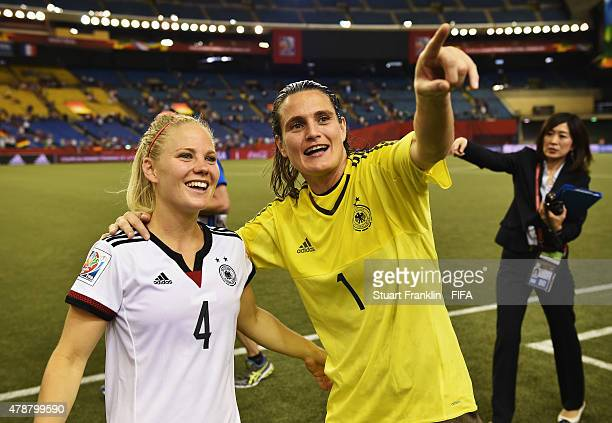 Nadine Angerer of Germany celebrates with Leonie Maier after the quarter final match of the FIFA Women's World Cup between Germany and France at...
