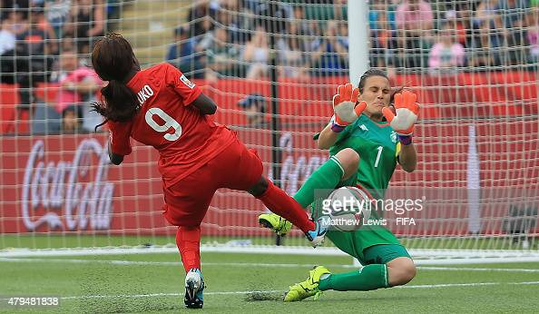 Nadine Angerer of Germany saves a shot from Eniola Aluko of England during the FIFA Women's World Cup 2015 Third Place Playoff match between Germany...