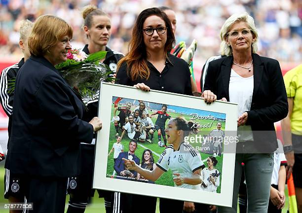 Nadine Kessler is honred by Hannelore Ratzeburg and head coach Silvia Neid during the women's international friendly match between Germnay and Ghana...