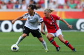 Nadine Kessler of Germany and Solveig Gulbrandsen of Norway battle for the ball during the UEFA Women's Euro 2013 group B match between Germany and...