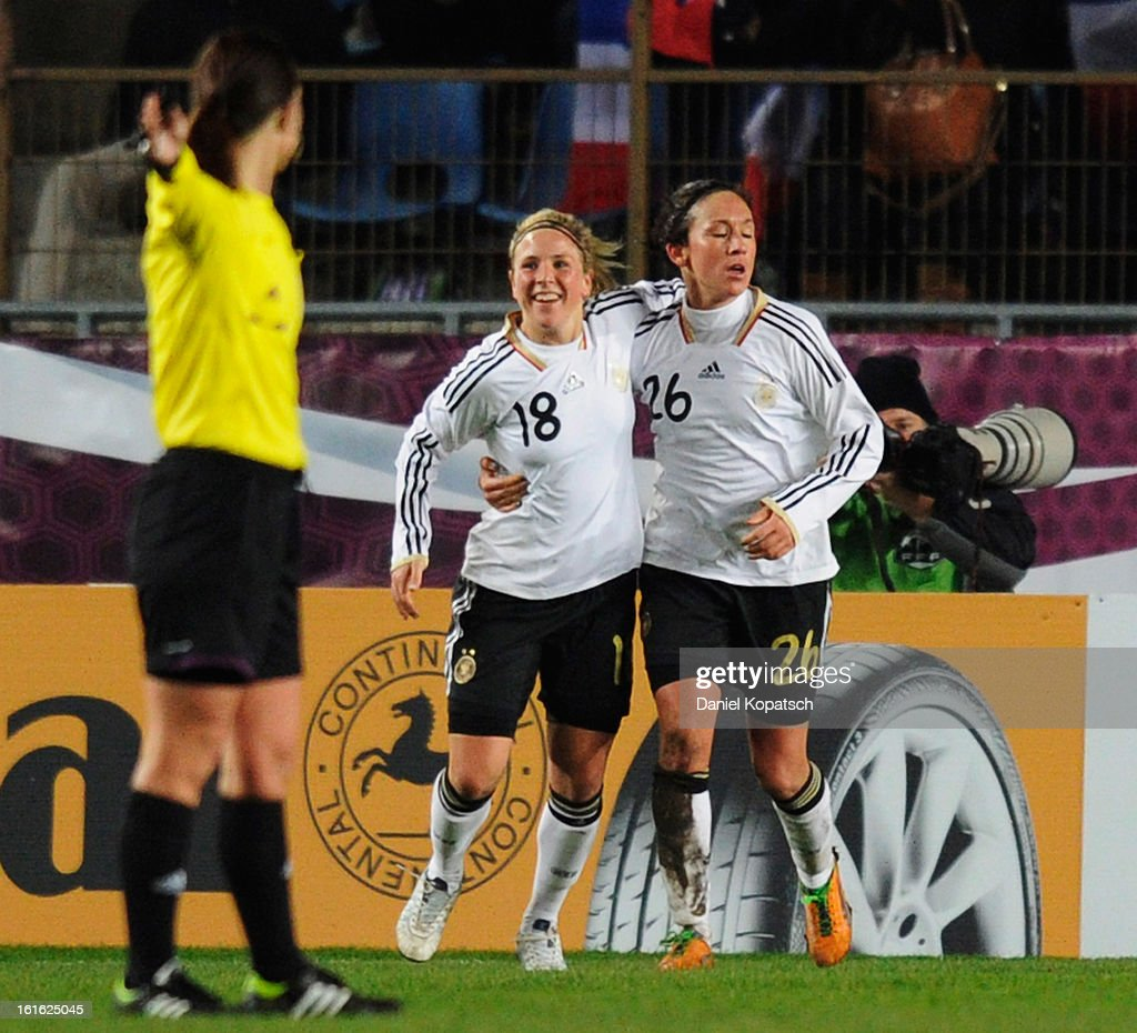 Nadine Kessler of Germany (R) celebrates her team's third goal with team mate Svenja Huth during the international friendly match between France and Germany at Stade de la Meinau on February 13, 2013 in Strasbourg, France.