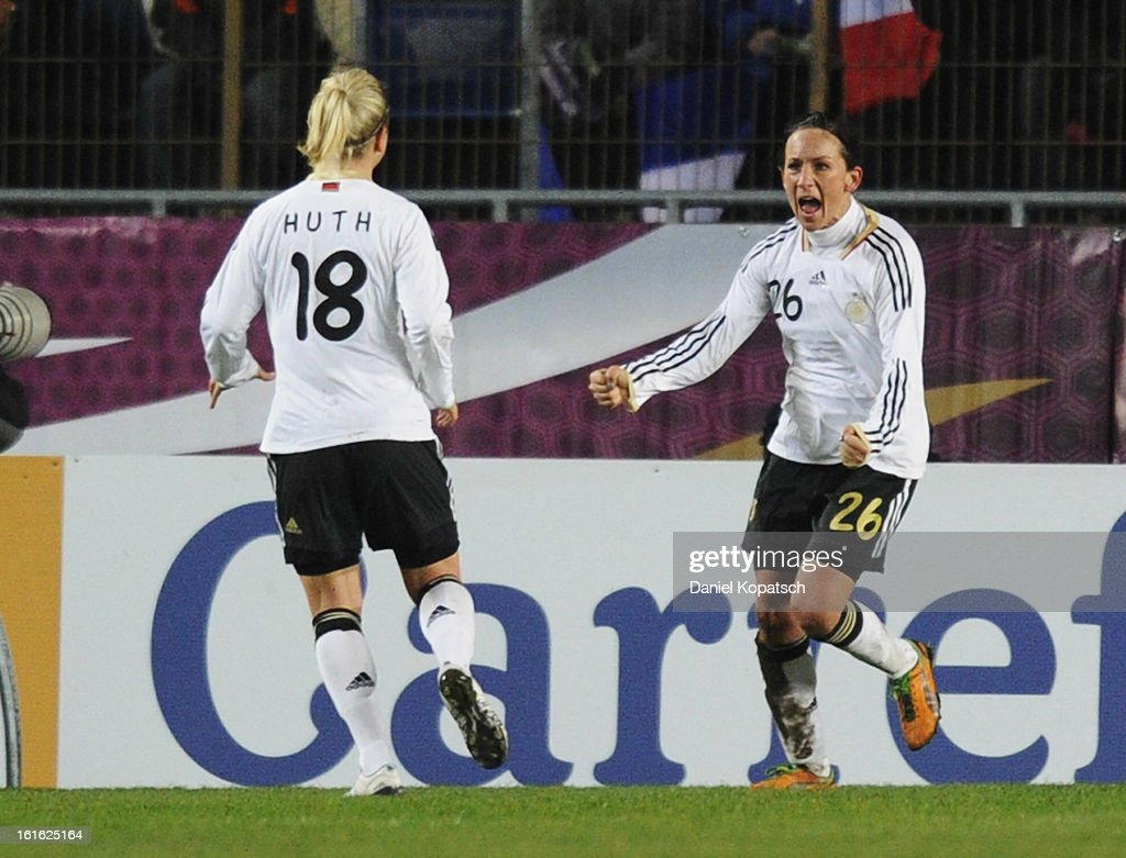 <a gi-track='captionPersonalityLinkClicked' href=/galleries/search?phrase=Nadine+Kessler&family=editorial&specificpeople=683339 ng-click='$event.stopPropagation()'>Nadine Kessler</a> of Germany (R) celebrates her team's third goal with team mate <a gi-track='captionPersonalityLinkClicked' href=/galleries/search?phrase=Svenja+Huth&family=editorial&specificpeople=701764 ng-click='$event.stopPropagation()'>Svenja Huth</a> during the international friendly match between France and Germany at Stade de la Meinau on February 13, 2013 in Strasbourg, France.
