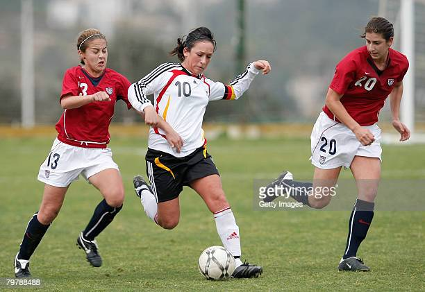 Nadine Kessler of Germany gets between Brittany Klein and Yael Averbuch of the US during their U23 women's friendly football match at the La Manga...