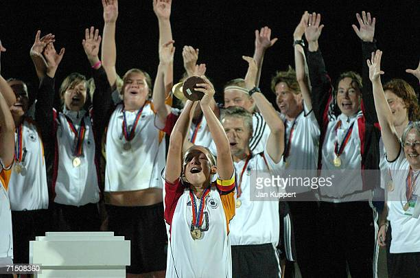 Nadine Kessler of Germany holds the trophy aloft after the Women's U19 Europen Championship match between Germany and France at Stadium Neufeld on...