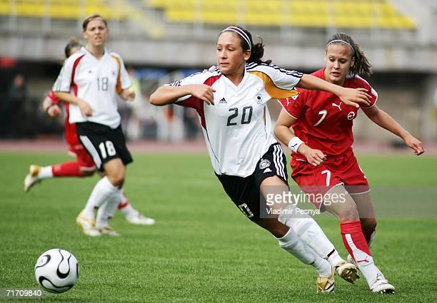 Nadine Kessler of Germany tackles Vanessa Buerki of Switzerland during the FIFA Women's Under 20 World Championships Group C match between Germany...