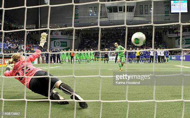 Nadine Kessler of VfL 1945 Wolfsburg shoots past Goalkeeper Katja Schroffenegger of FF USV Jena as she takes a penalty kick during the DFB Women's...