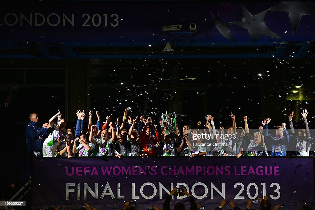 <a gi-track='captionPersonalityLinkClicked' href=/galleries/search?phrase=Nadine+Kessler&family=editorial&specificpeople=683339 ng-click='$event.stopPropagation()'>Nadine Kessler</a> of VfL Wolfsburg and her team mates celebrate with the trophy after victory in the UEFA Women's Champions League Final Match between VfL Wolfsburg and Olympique Lyonnais at Stamford Bridge on May 23, 2013 in London, England.