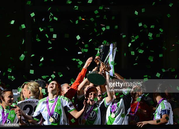 Nadine Kessler of VfL Wolfsburg lifts the trophy after victory in the UEFA Women's Champions League Final Match between VfL Wolfsburg and Olympique...