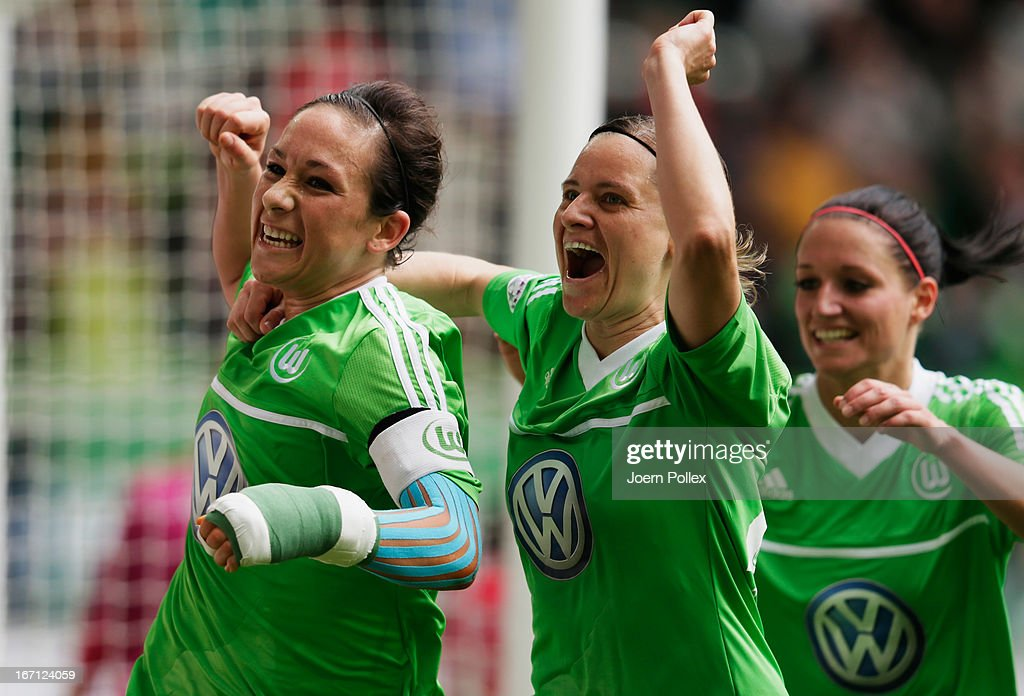 <a gi-track='captionPersonalityLinkClicked' href=/galleries/search?phrase=Nadine+Kessler&family=editorial&specificpeople=683339 ng-click='$event.stopPropagation()'>Nadine Kessler</a> (L) of Wolfsburg celebrates with her team mates after scoring her team's second goal during the Women's Champions League semi-final second leg match between VfL Wolfsburg and Arsenal Ladies FC at Volkswagen Arena on April 21, 2013 in Wolfsburg, Germany.