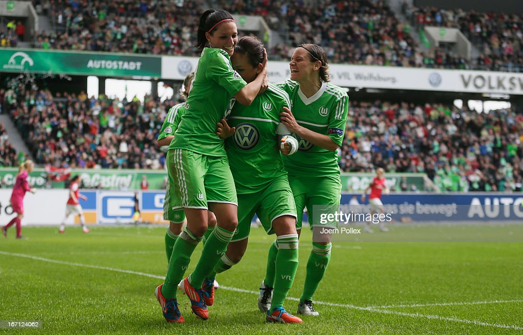<a gi-track='captionPersonalityLinkClicked' href=/galleries/search?phrase=Nadine+Kessler&family=editorial&specificpeople=683339 ng-click='$event.stopPropagation()'>Nadine Kessler</a> (C) of Wolfsburg celebrates with her team mates after scoring her team's second goal during the Women's Champions League semi-final second leg match between VfL Wolfsburg and Arsenal Ladies FC at Volkswagen Arena on April 21, 2013 in Wolfsburg, Germany.