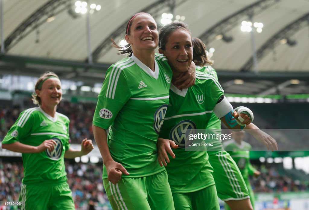 <a gi-track='captionPersonalityLinkClicked' href=/galleries/search?phrase=Nadine+Kessler&family=editorial&specificpeople=683339 ng-click='$event.stopPropagation()'>Nadine Kessler</a> (R) of Wolfsburg celebrates with her team mates after scoring her team's second goal during the Women's Champions League semi-final second leg match between VfL Wolfsburg and Arsenal Ladies FC at Volkswagen Arena on April 21, 2013 in Wolfsburg, Germany.