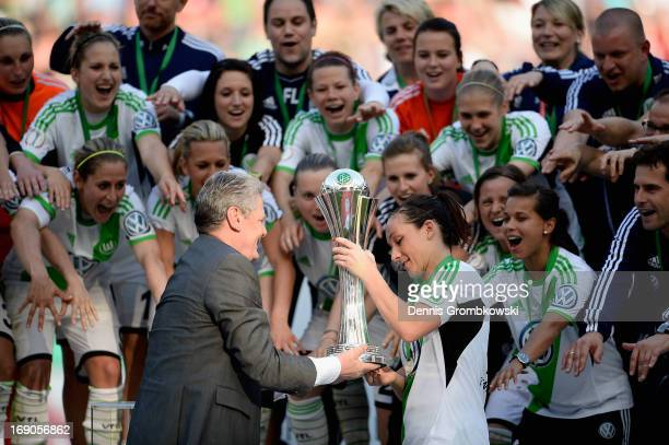 Nadine Kessler of Wolfsburg receives the trophy from German Fedreal President Joachim Gauck after winning the Women's DFB Cup Final between VfL...