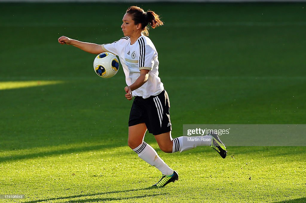 <a gi-track='captionPersonalityLinkClicked' href=/galleries/search?phrase=Nadine+Kessler&family=editorial&specificpeople=683339 ng-click='$event.stopPropagation()'>Nadine Kessler</a> runs with the ball during the training session of Germany at Vaxjo Arena on July 20, 2013 in Vaxjo, Sweden.