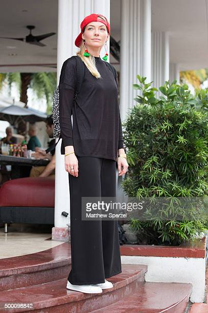 Nadine Kuschall is seen on the street in South Beach wearing a Saint Laurent backpack Adidas shoes Tadashi trousers vintage earings a Casio watch...