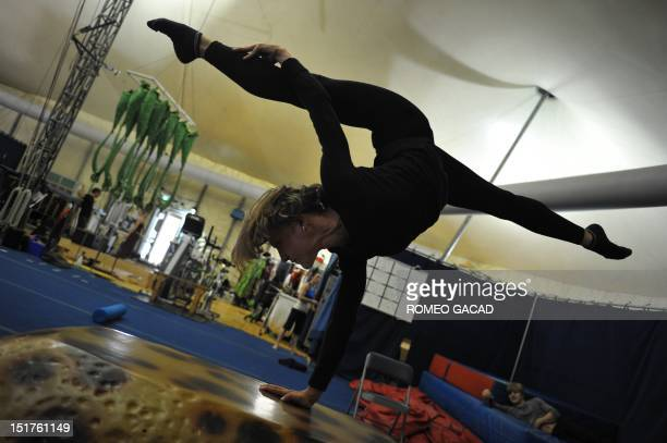 Nadine Louie a performer of the world famous trouple Cirque du Soleil practices her acrobatic routine in the backstage area of the big top tent in...