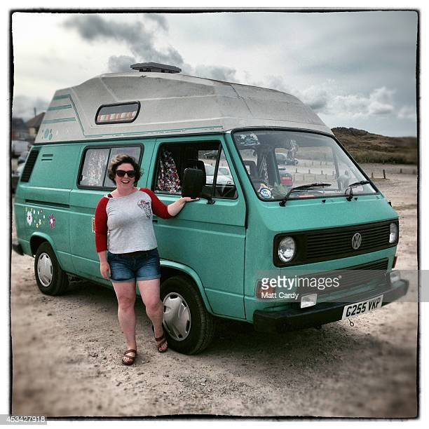 Nadine Smith from Colchester poses for a photograph besides her 1989 third generation or T25 Volkswagen Transporter van near Newquay on August 8 2014...