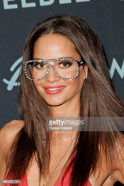 Nadine Vinzens wears Kaszluv Swarovski Crystal Glasses and attend the Sweeble and Arsenic Magazine party on July 11 2015 in Studio City California
